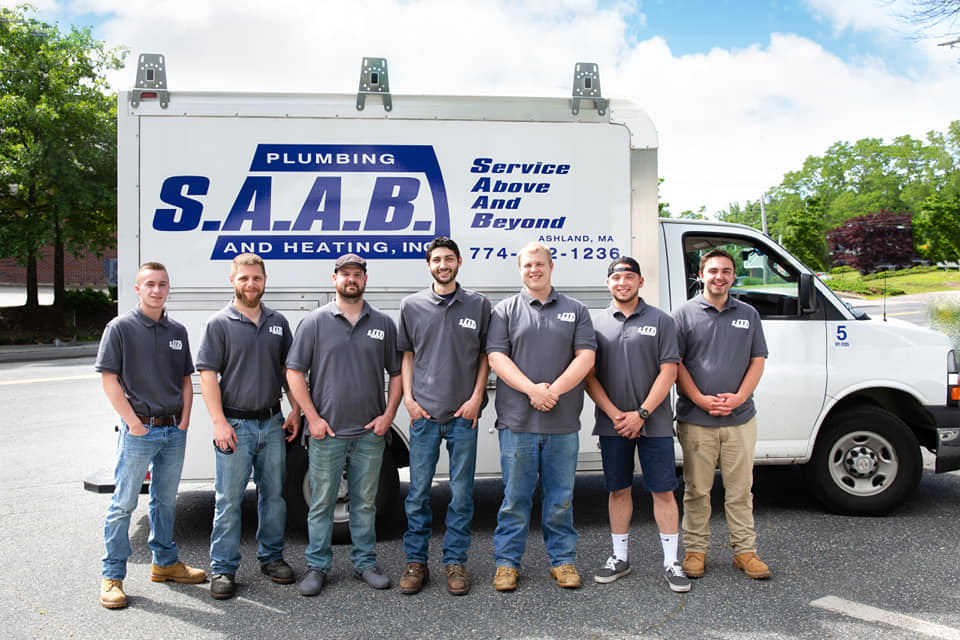 SAAB Plumbing and Heating Crew In Front Of Work Van